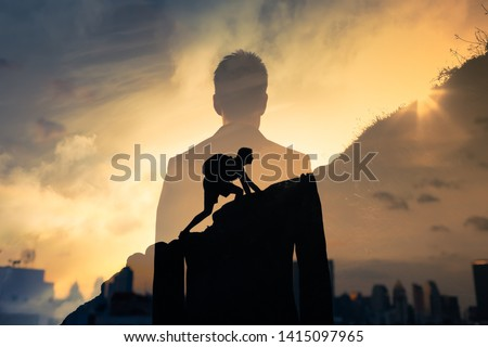 People Never giving up, strength and power. Man feeling determined climbing up a steep mountainside. Royalty-Free Stock Photo #1415097965