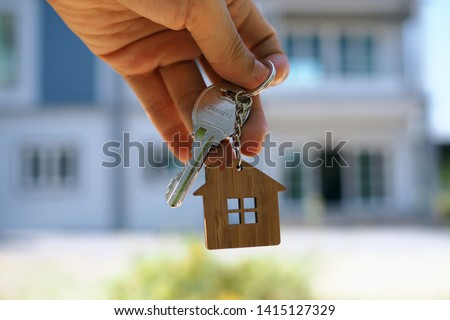 Landlord unlocks the house key for new home #1415127329