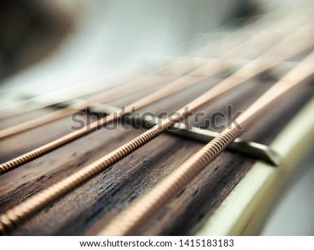 Guitar brass strings closeup macro #1415183183