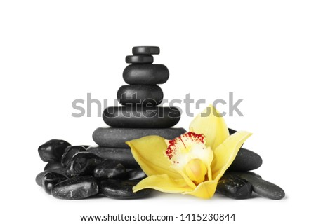 Spa stones and beautiful orchid on white background #1415230844
