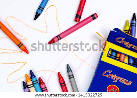 A Child's Crayon Drawing of a Hand with Generic Crayons and a generic Crayon Box. #1415322725