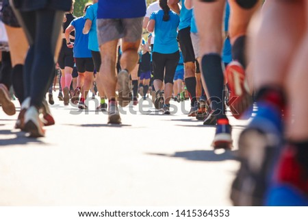 Marathon runners on the street. Healthy lifestyle. Athletes endurance  #1415364353