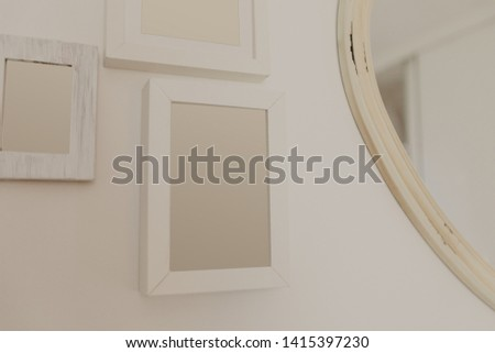 white wooden frames hanging on wall - Image  #1415397230
