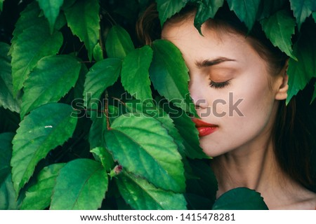 Green leaves close eyes delicate makeup red lips woman park                         #1415478281
