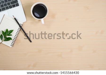 Flay lay, Top view office table wood desk with laptop computer, coffee, pen, leaves with copy space background. #1415566430