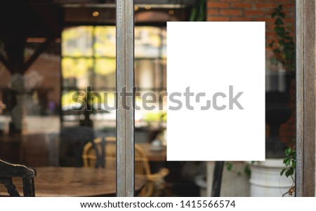 Mockup billboards or white promotion poster displayed on the front of the restaurant, coffee shop Promotion information for marketing announcements and details #1415566574