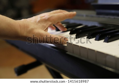 playing the piano, approaching the hand and fingers #1415618987