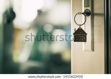House model and key in house door. Real estate agent offer house, property insurance and security, affordable housing concepts #1415622410
