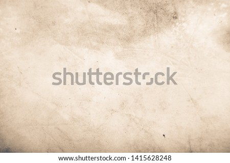 Vintage and antique background frame art concept. Front view of blank old aged dirty photo paper texture with stains and scratches. Detailed closeup studio shot #1415628248