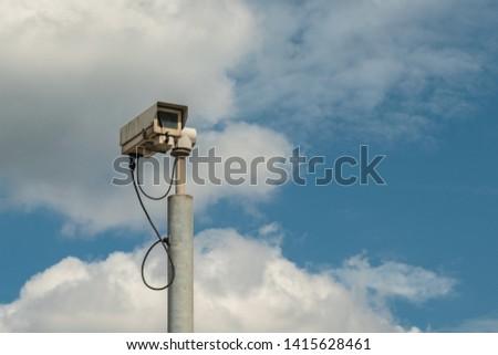 A typical radar trap or speed camera on blue sky