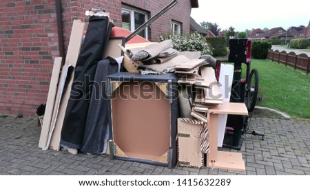 Bulky waste on the street is waiting for garbage collection. Waste collection. Bulky trash, a pile of mixed garbage. Rubbish. Recycling industry. Ecology. Recycled materials and wastes Royalty-Free Stock Photo #1415632289
