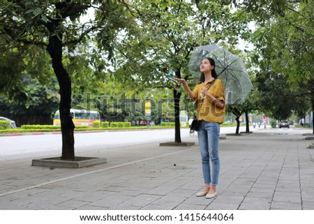 woman with umbrella in town #1415644064