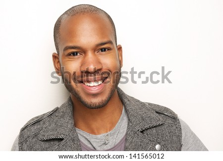 Close up portrait of a handsome young man smiling #141565012