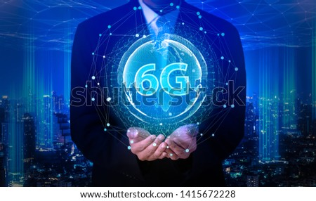 Businessman hand holding 6G network digital hologram and internet of things on city background.6G network wireless systems.IoT(Internet of Things),communication network concept. #1415672228