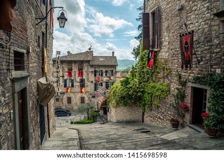 Gubbio, Italy - May 21 2019: Streets and buildings in the historic city of Gubbio, Italy. #1415698598