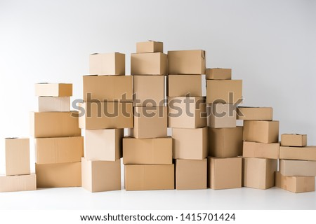 brown cardboard boxes stacked on each other on white  #1415701424