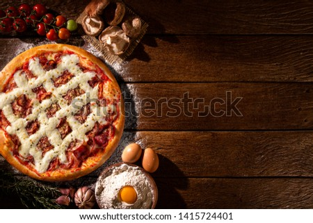 Pizza pepperoni with cream cheese on wood background. Top view, close up. Traditional Brazilian Pizza #1415724401