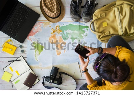 Vacation travel planning concept with map. Overhead view of equipment for travelers. Travel concept background, young Asian woman. Concept on vacation trip, Travel holiday, summer. #1415727371