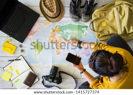 Vacation travel planning concept with map. Overhead view of equipment for travelers. Travel concept background, Young woman pointing to the map Saudi Arabia. Travel holiday, summer. #1415727374