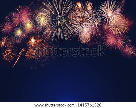 colorful fireworks on the black sky background with free space for text. Celebration and anniversary concept #1415761520