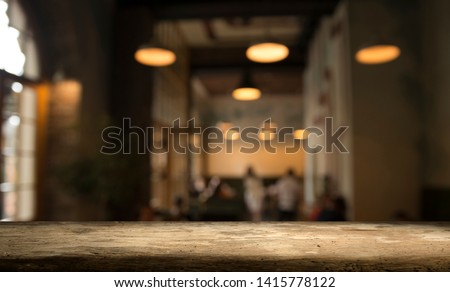 blurred background of bar and dark brown desk space of retro wood #1415778122