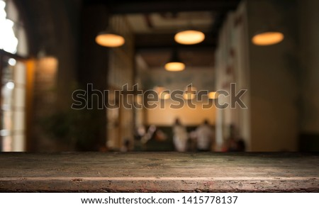 blurred background of bar and dark brown desk space of retro wood #1415778137