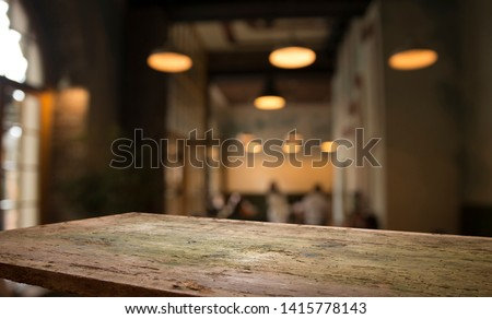 blurred background of bar and dark brown desk space of retro wood #1415778143