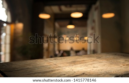 blurred background of bar and dark brown desk space of retro wood #1415778146