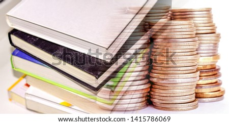 Books and printed publications on the background of money . The concept of copyright . #1415786069
