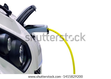 Close-up gripping of electric charge machine connected with plug for charging battery on smart car (EV Car), Electric power is an alternative fuel for smart vehicles, isolated on white background #1415829200