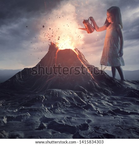 A little girl stands above a volano and pours water to put out the flames Royalty-Free Stock Photo #1415834303