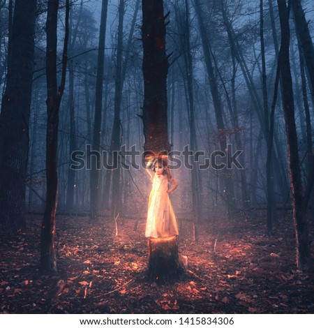 A surreal image of a little girl lifting up a large tree Royalty-Free Stock Photo #1415834306