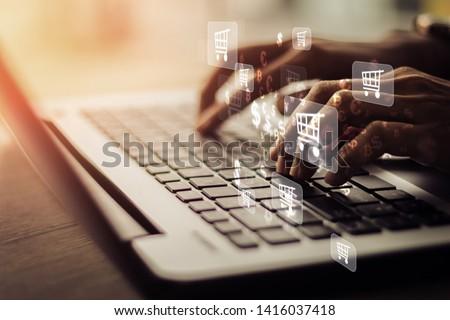 Businesswoman laptop using , online shopping concept.Vintage concept #1416037418
