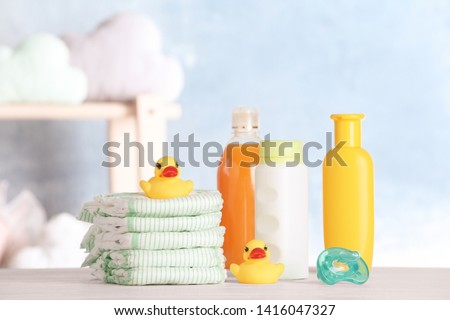 Set with baby accessories on table indoors #1416047327