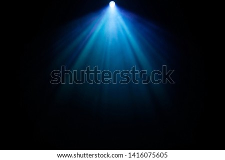blue spotlight projector at top shiny beam for knowledge and education futuristic concept on abstract smoke texture . glowing screening for cinematography and filming multimedia production . #1416075605
