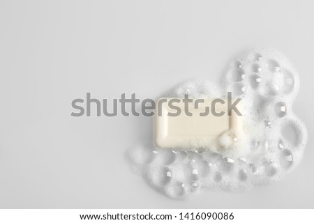 Soap bar and foam on white background, top view. Mockup for design #1416090086