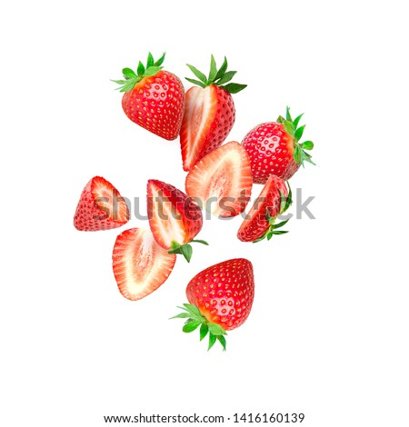 The composition of strawberries on white background. Cut strawberries into pieces with copy space. Fresh natural strawberry isolated. Strawberry slices flying in the air #1416160139