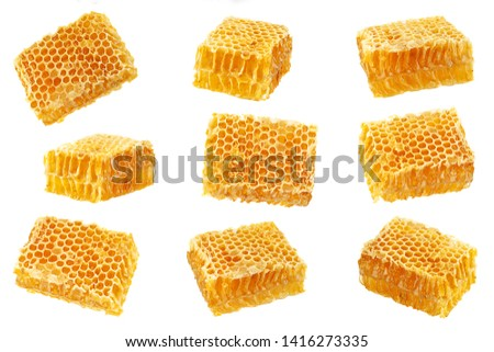 Yellow Honeycomb slice set closeup isolated on white background Royalty-Free Stock Photo #1416273335