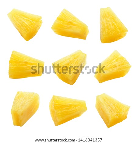 Canned pineapple chunks. Pineapple slices isolated. Set of pineapple chunks. Clipping path. #1416341357
