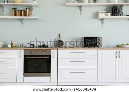 Interior of kitchen with modern oven #1416345494