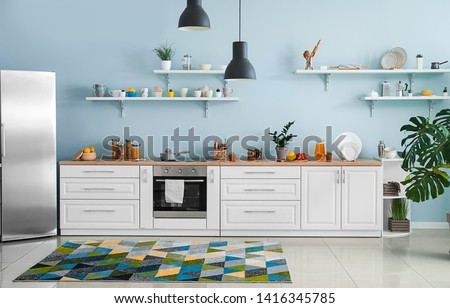 Interior of modern comfortable kitchen #1416345785