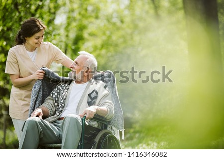 Careful caregiver taking care of the patient #1416346082