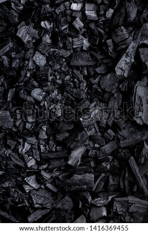 Flat lay of coal mineral black stones background. Coal pattern studio background #1416369455