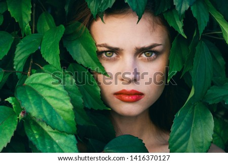 Beautiful woman red lips green shrub model nature tropics #1416370127