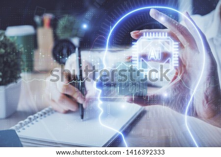 Multi exposure of writing hand on background with brain hologram. Concept of learning. #1416392333