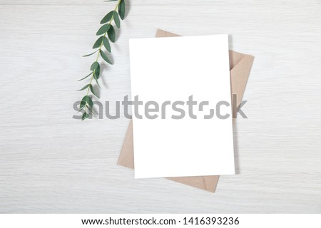 Wedding Invitation Mockup, Blank Party Invitation Card with a Sprig of Eucalyptus Royalty-Free Stock Photo #1416393236