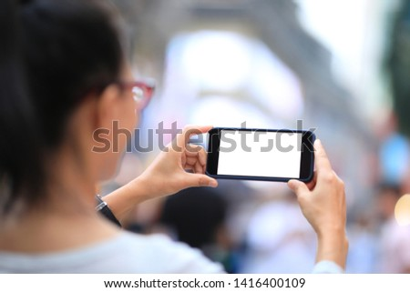 Woman use smartphone at city #1416400109