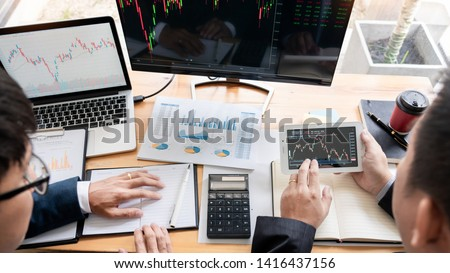 Business Team Investment Entrepreneur Trading discussing and analysis data the stock market charts and graphs negotiation and research budget, teamwork traders #1416437156