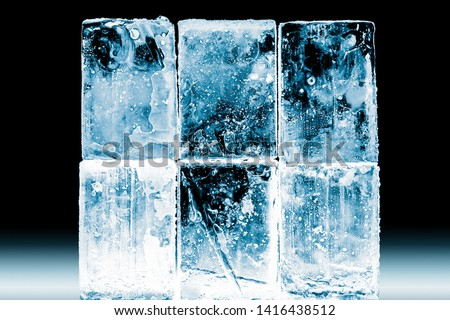 Textured frosty crystal clear ice blocks isolated on black background. #1416438512