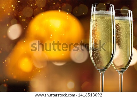 Two glasses of champagne isolated on white background #1416513092